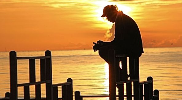 man-praying-sunrise-rgbstock